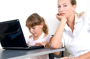 mother and daughter working on laptop